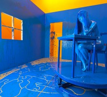 Richard Jackson – The Blue Room. 2011, Fiberglass, steel, wood, formica, urethane paint, acrylic, paint, canvas, wig, motor, rubber and control panel, Variable dimensions. Rubell Family Collection, Miami.