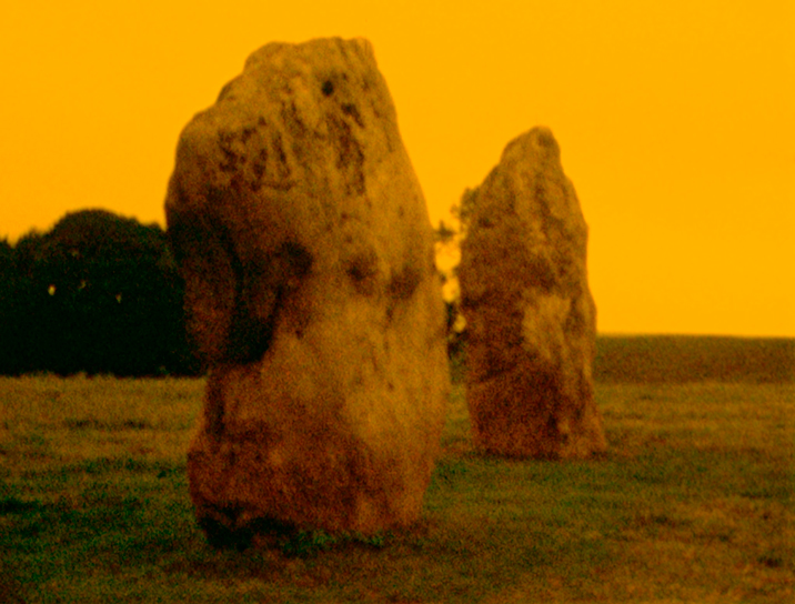 A still from Journey to Avebury, a landscape film saturated in gold that maps the great Neolithic stone circle and its surroundings at Avebury. All images are © 2014 LUMA Foundation.