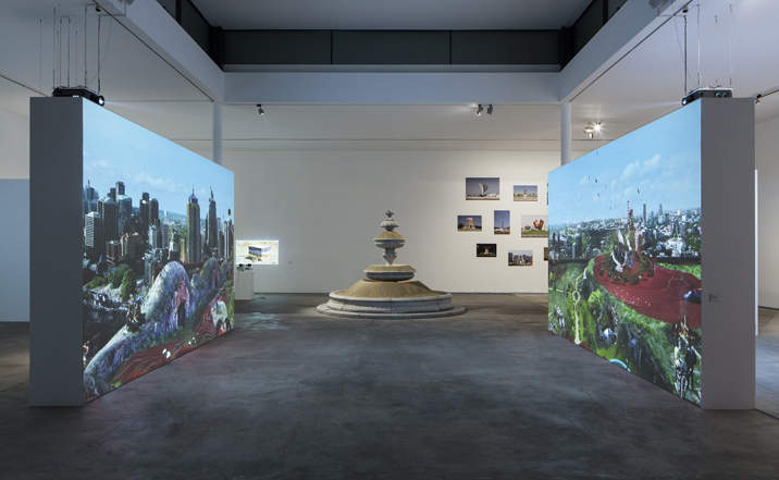 Installation view, V.l.n.r./F.l.t.r.: Ulu Braun: THE PARK, 2011 Basim Magdy: MY FATHER LOOKS FOR AN HONEST CITY, 2010, Klaus Weber: SANDFOUNTAIN, 2012 Sophie-Therese Trenka-Dalton: From the series ROUNDABOUT MONUMENTS IN THE UAE, 2014, Photo by Timo Ohler