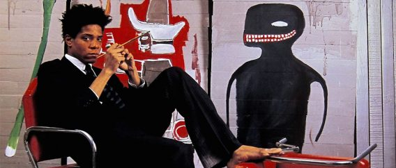 Jean-Michel Basquiat wearing an Armani Suit. Image from bevelcode.com