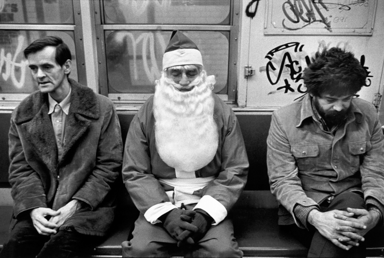 Richard Kalvar USA. New York. Santa Claus and others in the subway. 1976.